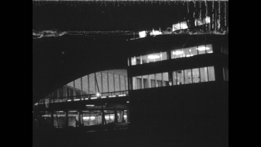 UNITED STATES 1960s: airport terminal building / man speaking / men staring at instruments | Shutterstock HD Video #13694300