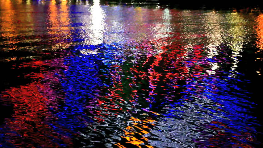 Colorful light reflections on water, abstract motion background.    Shutterstock HD Video #1370743