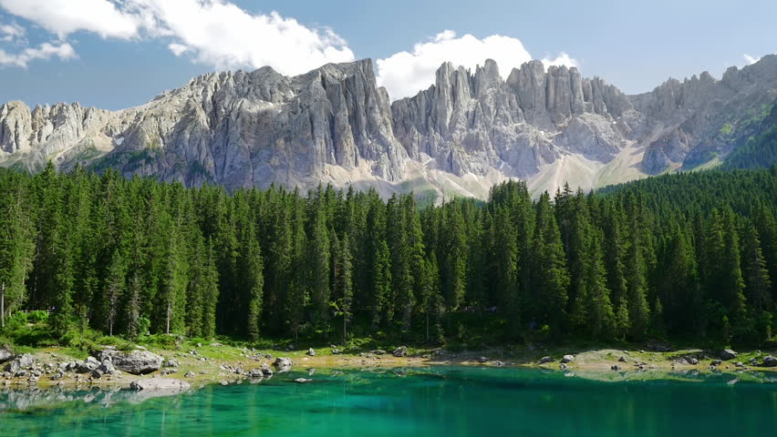 Lake Lago di Carezza (Karersee) in the Italian Dolomites at sunny summer day. Timelapse video.