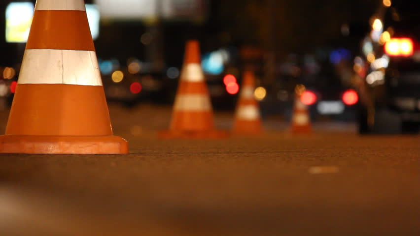 traffic cones exhibited in the line of the roadway and their cars go round