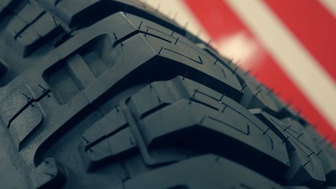 Closeup of various new tire tread. New tires of trucks with large tread for better grip