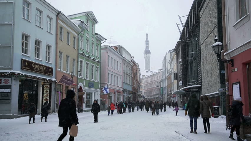 TALLIN, ESTONIA - JANUARY 5, 2016: A street with a tower in Old Tallinn, Estonia in winter heavy snowfall