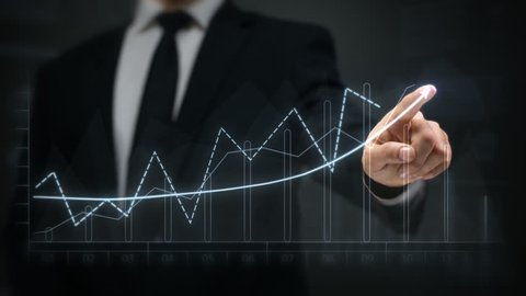 Businessman drawing an ascending financial chart. Touchscreen. 2 colors in 1 file. White and blue. Businessman drawing a bright arrow showing increasing profits in a financial chart. Business success.