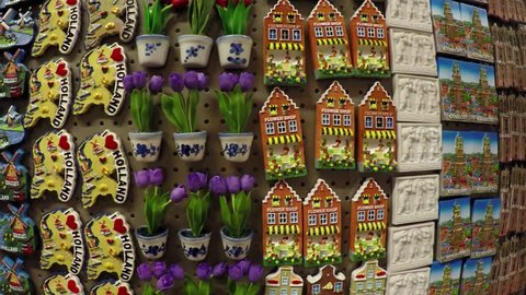 Dutch refrigerator magnets in a tourist shop in Holland the Netherlands very colorful display with small Dom Towers tulips canal houses wooden shoes magnets made for tourism popular as presents 4k