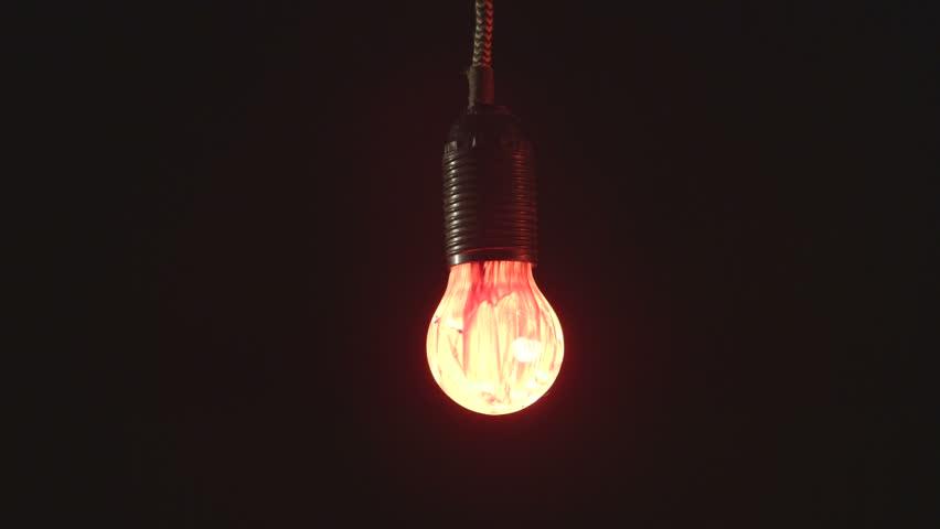 Light In Dark Room hand installing electric light bulb in dark room stock footage