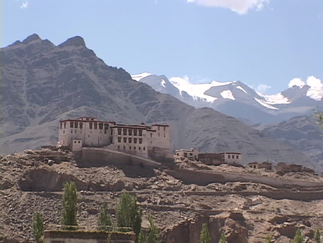 A Buddhist monastery nestles in the mountains.
