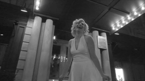 Marilyn Monroe in black and white in front of hotel laughing from The Seven Year Itch in 1080p HD