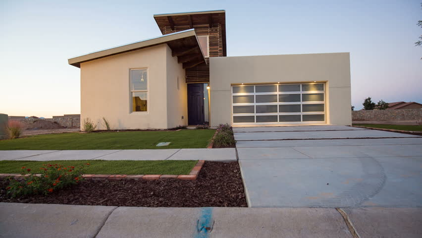 Rising from Street to Show Modern Southwestern Home. camera rises from the front road to reveal modern southwestern home during sunrise. Unique style for the area.