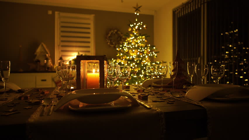 4k Footage Slow Dolly Move Of Lighted Christmas Tree With Decorated Dinner Table In Living