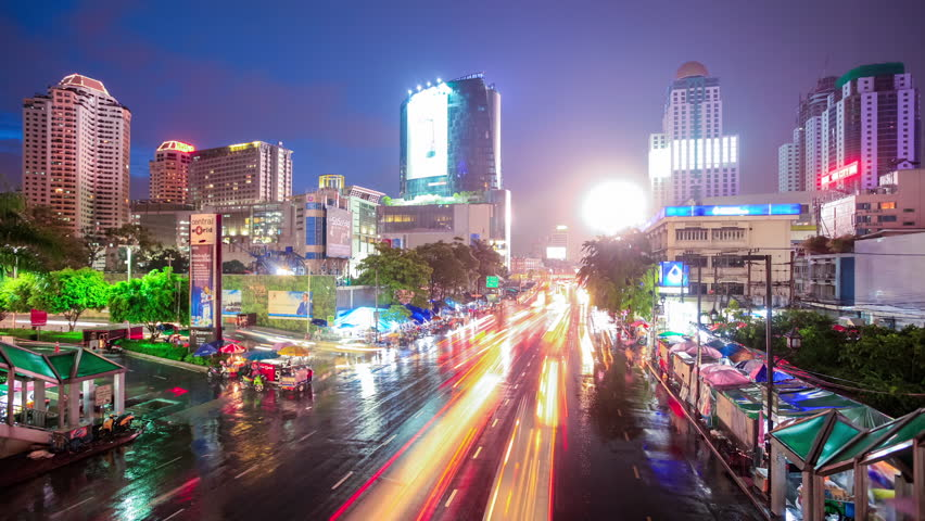 BANGKOK, NOV 16, Timelapse view of the Siam city area in the centre of Bangkok at night in the rain on November 16, 2011 in Bangkok, Thailand