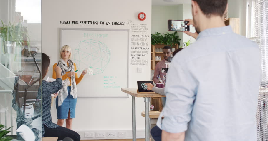Business team meeting young business woman presenting crowdsourcing plan idea to tech startup investors in trendy hipster office | Shutterstock HD Video #13949291