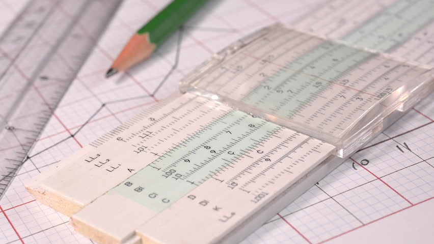 Using an old slide rule to make calculations in the construction of a graph. | Shutterstock HD Video #13965203