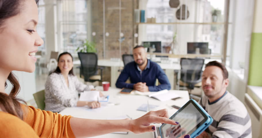 Creative Business team meeting woman manager presenting financial data to shareholders using digital tablet in casual modern office boardroom with natural light and large open windows | Shutterstock HD Video #13966103