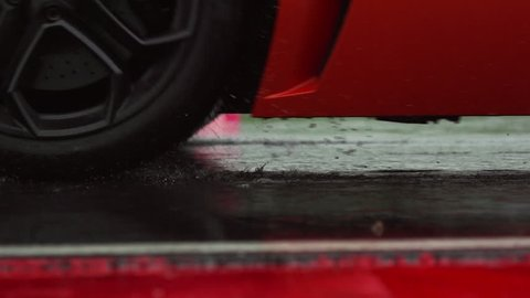 Rainy day,sport car, water drops, close-up.