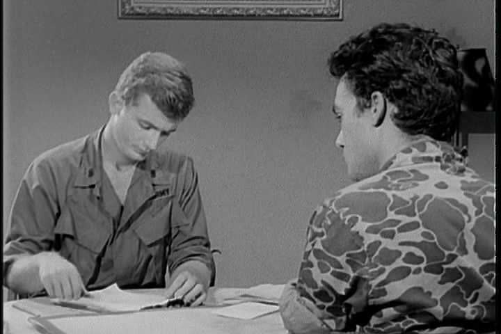 circa 1960s utilizing the direct approach a united states army interrogator finishes his interrogation
