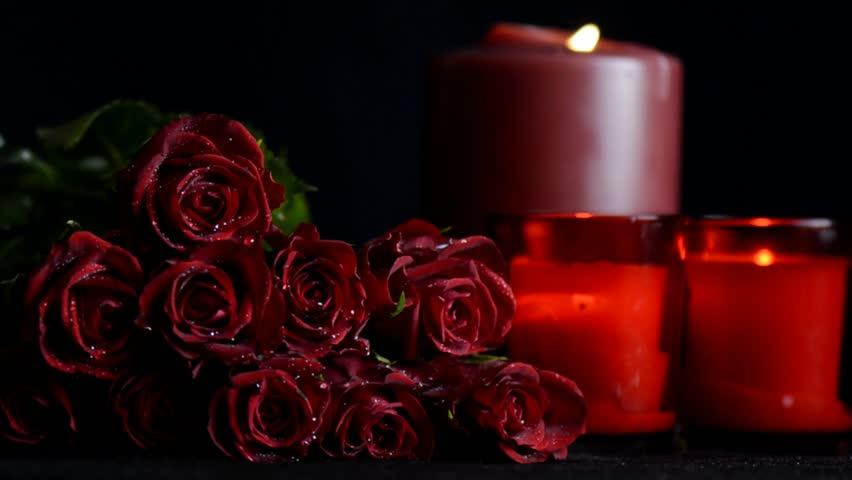Valentines Day Red Roses Zoom In With Burning Candles On Black Background Stock Footage Video 13989143 Shutterstock
