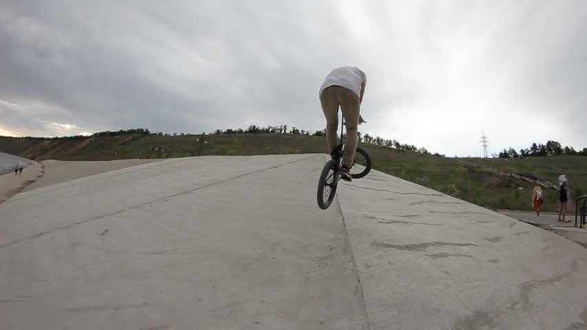 Extreme Sport BMX bike trick on skate park  #13990433