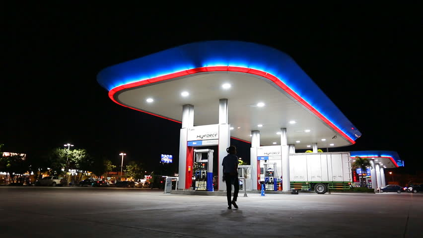 CHONBURI,THAILAND- NOVEMBER 20, 2015: PTT gas station with vehicle on night time at high way road during Chonburi city to Bangkok city , Chonburi ,Thailand  | Shutterstock HD Video #14008733