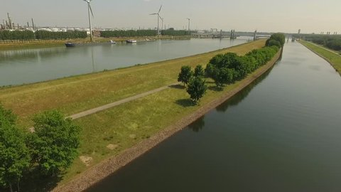 Aerial footage from the Botlek industrial zone in europoort Rotterdam. Highway and petrochemical plant. But we also can see sheep grazing. All shot on a sunny day during the summer.