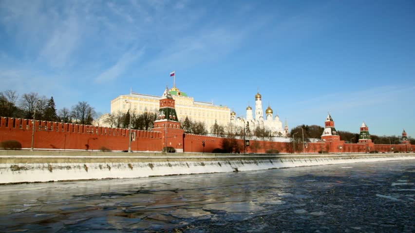 Quay and red brick walls of Moscow Kremlin and Ivan Great Bell Tower at winter