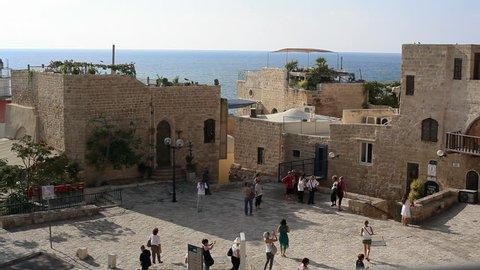 ISRAEL - CIRCA SEPTEMBER 2015 - Group of tourists walk around old Jaffa, Mediterranean sea, Tel-Aviv, Israel