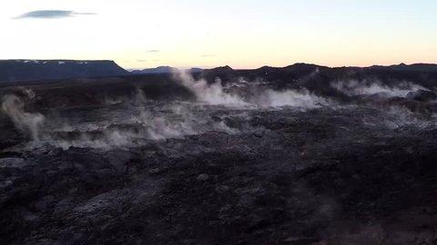 Aerial shot of volcanic landscape at sunset around Mount Krafla in Iceland