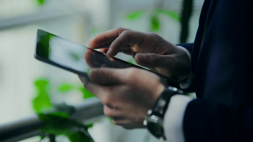 And successful business man with a phone and a tablet | Shutterstock HD Video #14099903
