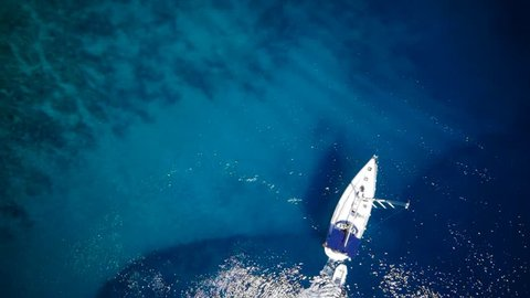 Yacht in amazing clear sea / ocean - water - taken from top by drone