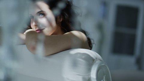 4k / Ultra HD version Beautiful brunette model wearing lingerie relaxing in her boudoir. Shot on RED Epic