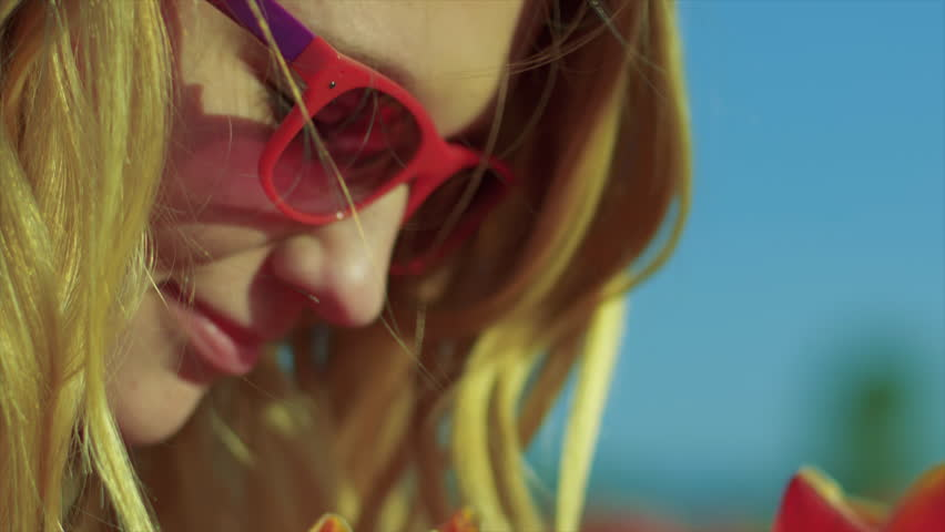 Young Girl Wearing Sunglasses Smelling Stock Footage Video 100