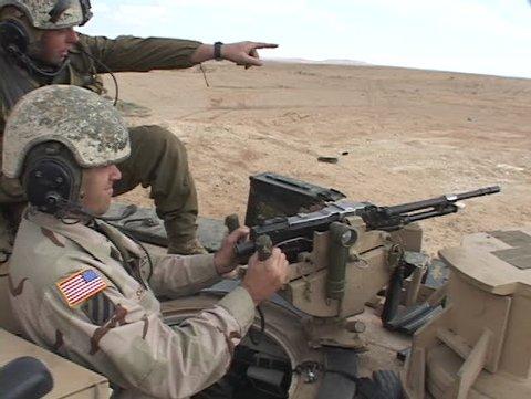 IRAQ - CIRCA 2003: U.S. soldiers fire a  machine gun from an Abrams tank circa 2003 in Iraq.