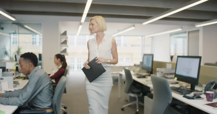 Business Power Woman Leader Walking Through Busy Corporate Office Planning Her Next Success Strategy