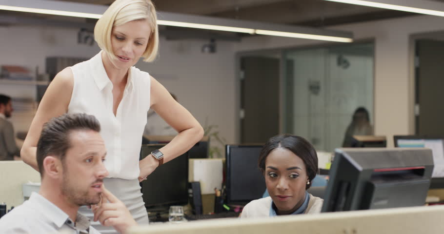 Creative business team meeting in modern start up office female team leader pointing at screen discussing diverse people group teamwork | Shutterstock HD Video #14143043