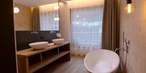 View of elegant bathroom in a stylish, classically designed home with a contemporary feel hotel