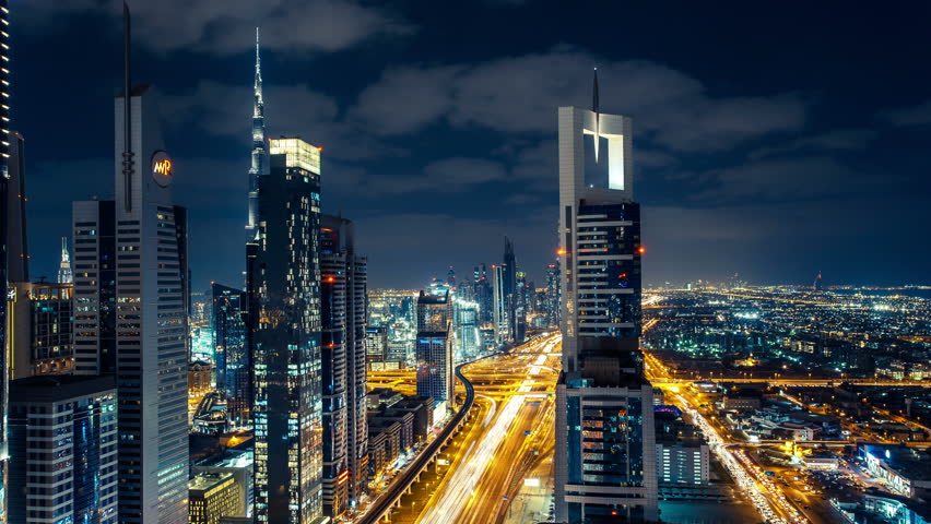 DUBAI, UAE - DECEMBER 16, 2015: Scenic Dubai downtown architecture at night. Aerial view of the Sheikh Zayed road with fast moving traffic. Time-lapse. #14160803
