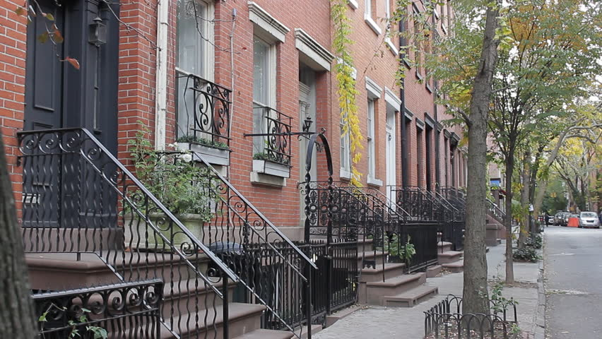 New York, NY - October, 2013: Stationary establishing shot of a New York street with Brownstones. Day. | Shutterstock HD Video #14164943