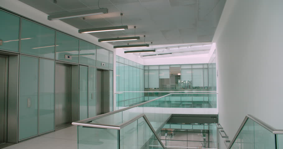 empty smoking room with transparent glass walls in airport. stock