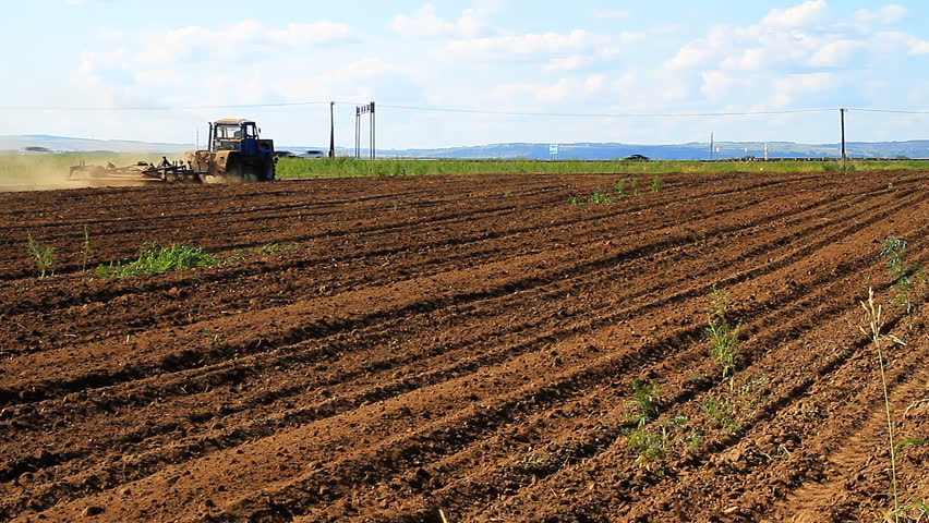 The Tractor Plows the Land   Shutterstock HD Video #14183543