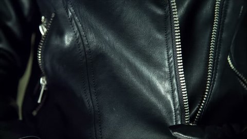 biker girl rocker or punk in black leather jackets. Fastens with a zipper on the jacket. ready to go