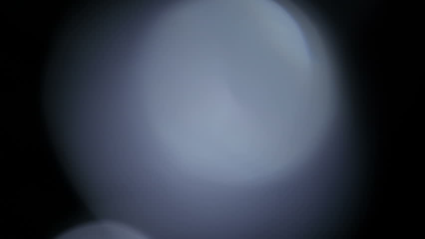 Light leak background. Abstract glitter defocused blinking background. Blurred bokeh. 4K UHD 2160p footage.
