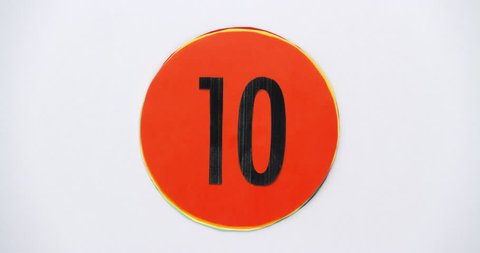 Countdown leader graphic 10 to 0. Stop motion animation with color paper.