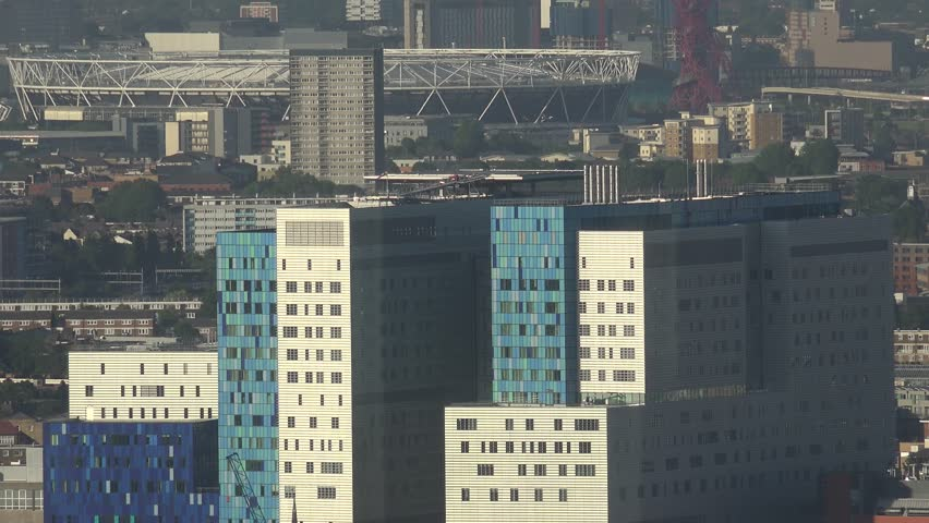 4K Aerial view of famous London stadium and town architecture with modern block design by day