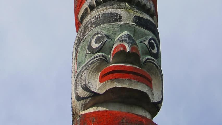 Totem pole topped  by thunderbird, Thunderbird Park, Victoria, BC, Canada
