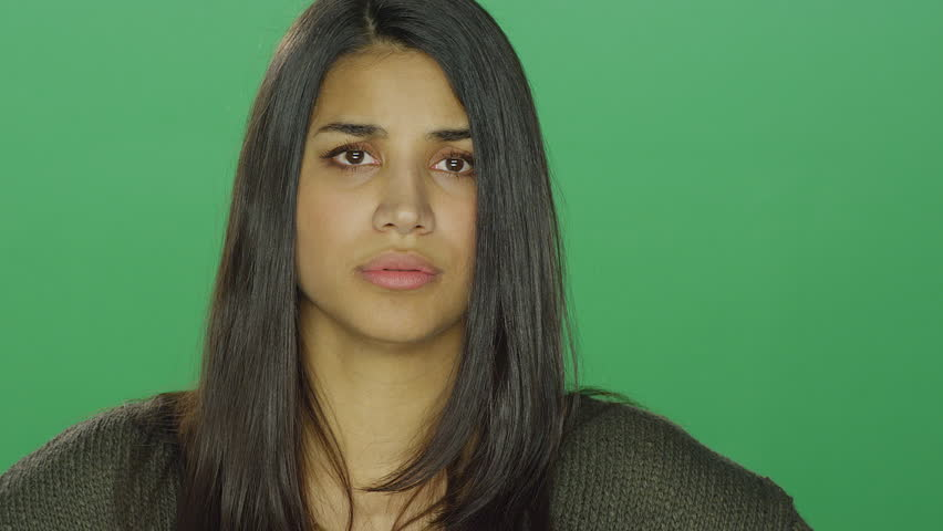 Young woman looking angry and starting to cry, on a green screen studio background | Shutterstock HD Video #14360383
