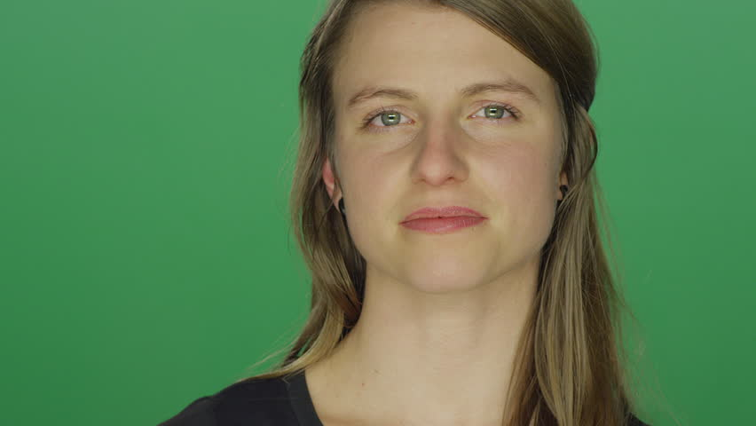 Young woman smiles after crying, on a green screen studio background | Shutterstock HD Video #14361313