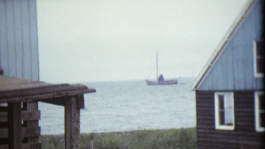 CIRCA 1968: Vintage 8mm film of a small harbor with sailing boats