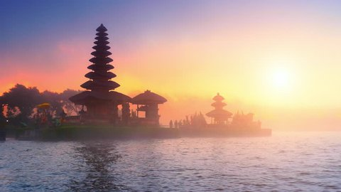 Bali temple silhouette and sunset sunshine over holy site in Indonesia