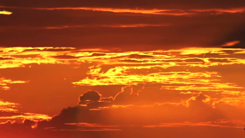 Time Lapse, Sun drops from behind fiery clouds at sunset. 1080p