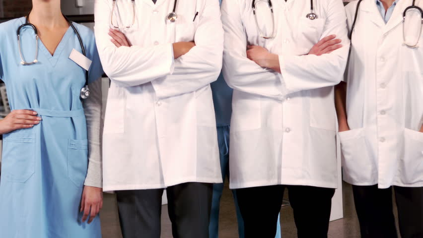 Smiling medical team standing together at hospital | Shutterstock HD Video #14424943