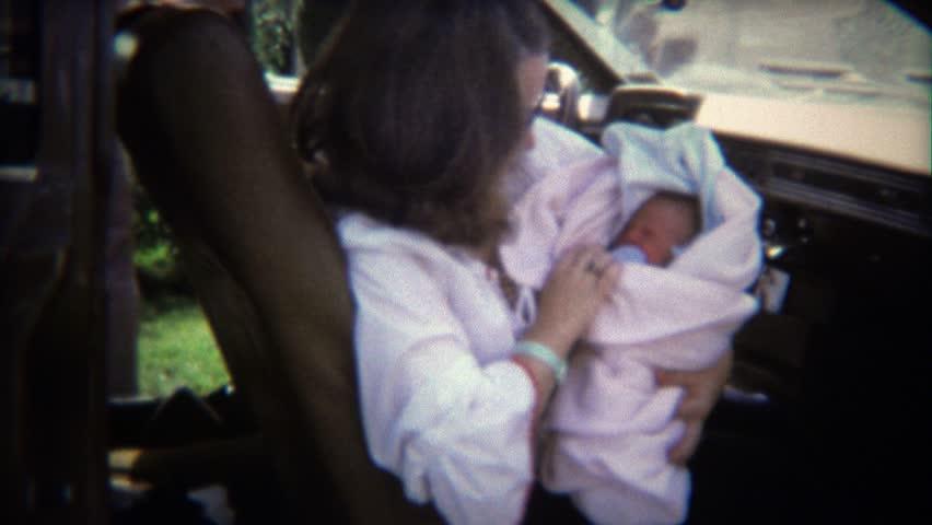 BOULDER, CO. 1970: Mom in car brings newborn baby boy home from hospital.